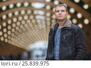 Купить «Half length portrait of young man in black jacket on background of lights installation main park alley, look throw», фото № 25839975, снято 25 октября 2015 г. (c) Losevsky Pavel / Фотобанк Лори