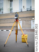 Купить «Total Station on the pavement in front of a residential building», фото № 25840003, снято 7 июля 2015 г. (c) Losevsky Pavel / Фотобанк Лори