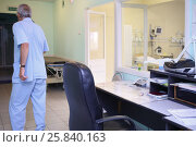 Купить «The man moves away from the workplace of the nurse near the intensive care unit, view from the back», фото № 25840163, снято 31 августа 2015 г. (c) Losevsky Pavel / Фотобанк Лори