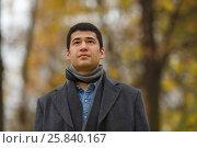 Купить «Half length portrait of young dark-haired man in black jacket in alley in park, close-up», фото № 25840167, снято 25 октября 2015 г. (c) Losevsky Pavel / Фотобанк Лори
