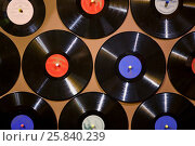 Купить «Old dusty damaged vinyl disks pinned to the yellow wall», фото № 25840239, снято 9 января 2015 г. (c) Losevsky Pavel / Фотобанк Лори
