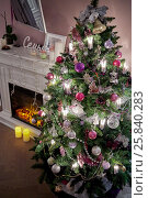 Decorated Christmas firtree near fireplace in room. Стоковое фото, фотограф Losevsky Pavel / Фотобанк Лори