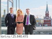 Купить «Portrait of two businessman and woman on the terrace overlooking Kremlin», фото № 25840415, снято 10 апреля 2014 г. (c) Losevsky Pavel / Фотобанк Лори