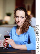 Купить «Woman in blue dress holds glass of red wine in restaurant, shallow dof», фото № 25840643, снято 12 июля 2015 г. (c) Losevsky Pavel / Фотобанк Лори