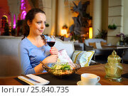 Купить «Woman holds glass with wine, smiles and drinks in cozy restaurant», фото № 25840735, снято 12 июля 2015 г. (c) Losevsky Pavel / Фотобанк Лори