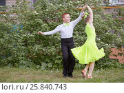 Купить «Little boy and girl dance ballroom dance outdoor at grassy lawn», фото № 25840743, снято 29 мая 2016 г. (c) Losevsky Pavel / Фотобанк Лори