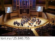 Купить «MOSCOW - APR 20, 2015: Orchestra performs at concert devoted to 100th anniversary of David Ashkenazy in House of Music, Svetlanov hall», фото № 25840755, снято 20 апреля 2015 г. (c) Losevsky Pavel / Фотобанк Лори