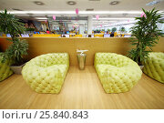Купить «MOSCOW - JUN 03, 2015: Leather couches in rest zone of office. Tinkoff Credit Systems is first Russian bank that has completely refused from branch of bank», фото № 25840843, снято 3 июня 2015 г. (c) Losevsky Pavel / Фотобанк Лори