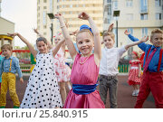 Купить «Eight little children dance at playground in courtyard, focus on first girl», фото № 25840915, снято 29 мая 2016 г. (c) Losevsky Pavel / Фотобанк Лори