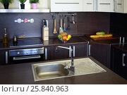 Купить «Empty kitchen with brown table with fruits, shiny sink, modern stove», фото № 25840963, снято 4 июня 2015 г. (c) Losevsky Pavel / Фотобанк Лори