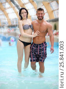 Happy tanned man and light-skinned woman in pool at the aquapark, фото № 25841003, снято 28 февраля 2015 г. (c) Losevsky Pavel / Фотобанк Лори