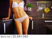 Купить «Pretty woman in white underwear poses near table in kitchen, noface», фото № 25841043, снято 4 июня 2015 г. (c) Losevsky Pavel / Фотобанк Лори