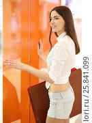 Купить «Beautiful girl in shorts poses with bags near showcase in modern mall», фото № 25841099, снято 21 апреля 2015 г. (c) Losevsky Pavel / Фотобанк Лори