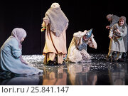 Купить «MOSCOW, RUSSIA - JAN 15, 2015: Praying women and beggars on square in front od Cathedral on stage of Moscow theatre Et Cetera in play Boris Godunov directed by Peter Stein», фото № 25841147, снято 15 января 2015 г. (c) Losevsky Pavel / Фотобанк Лори