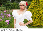 Купить «Half length portrait of beautiful woman in white dress in summer park on background of shrubs and flowers», фото № 25841163, снято 16 июля 2015 г. (c) Losevsky Pavel / Фотобанк Лори