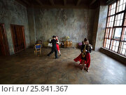 MOSCOW - FEB 9, 2016: Woman in dress and man in hat dance tango and girl plays sax (models with relases) Cross Photo studio - Amber Hall. Редакционное фото, фотограф Losevsky Pavel / Фотобанк Лори