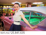 Young woman in retro dress in bar touching pink car. Стоковое фото, фотограф Losevsky Pavel / Фотобанк Лори
