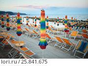 Купить «Empty beach with folded umbrellas and lounges on coastline in evening», фото № 25841675, снято 5 августа 2016 г. (c) Losevsky Pavel / Фотобанк Лори