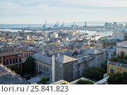 Купить «GENOA, ITALY - AUG 6, 2016: View at Port of Genoa with cranes and old lighthouse. Port of Genoa is the major Italian port on the Mediterranean Sea.», фото № 25841823, снято 6 августа 2016 г. (c) Losevsky Pavel / Фотобанк Лори