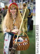 Купить «MOSCOW - OCT 12, 2014: A girl dressed as Baba Yaga with a broom at the EveryCon 2014 in the exhibition center Sokolniki», фото № 25841855, снято 12 октября 2014 г. (c) Losevsky Pavel / Фотобанк Лори