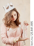 Купить «Young woman in pink dress with pearl necklace, beads and crown on head», фото № 25841895, снято 7 марта 2015 г. (c) Losevsky Pavel / Фотобанк Лори