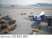Купить «SEOUL - NOV 05, 2015: Several planes on runway and terminals of Incheon airport is largest aviation hub of country», фото № 25841987, снято 5 ноября 2015 г. (c) Losevsky Pavel / Фотобанк Лори