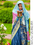 Купить «Middle age woman in blue sari and Indian adornment holds petals in summer park», фото № 25842051, снято 19 июля 2015 г. (c) Losevsky Pavel / Фотобанк Лори