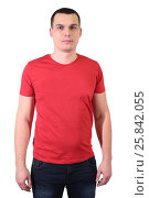 Купить «Portrait of a handsome man in red T-shirt isolated on white», фото № 25842055, снято 10 декабря 2014 г. (c) Losevsky Pavel / Фотобанк Лори