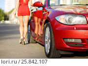 MOSCOW - SEP 13, 2015: Woman (with model release) goes near BMW cabriolet car, Company was founded by Karl Friedrich Rapp in October 1916, focus on car. Редакционное фото, фотограф Losevsky Pavel / Фотобанк Лори