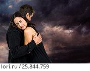 Купить «Sad couple hugging against dark cloudy sky», фото № 25844759, снято 30 мая 2020 г. (c) Wavebreak Media / Фотобанк Лори