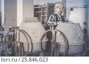 Купить «working man practicing his skills with mixing unit at workshop», фото № 25846023, снято 17 января 2017 г. (c) Яков Филимонов / Фотобанк Лори