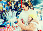 Happy woman with daughter buying gifts, фото № 25846299, снято 29 марта 2017 г. (c) Яков Филимонов / Фотобанк Лори