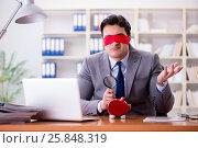 Купить «Blindfold businessman sitting at desk in office», фото № 25848319, снято 2 февраля 2017 г. (c) Elnur / Фотобанк Лори