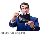 Купить «Handsome man with movie clapper isolated on white», фото № 25848843, снято 5 ноября 2016 г. (c) Elnur / Фотобанк Лори