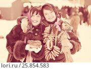 Купить «girls with pancake and round cracknel during Shrovetide», фото № 25854583, снято 6 марта 2011 г. (c) Яков Филимонов / Фотобанк Лори