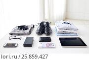 Купить «clothes, gadgets and business stuff on table», фото № 25859427, снято 13 ноября 2014 г. (c) Syda Productions / Фотобанк Лори