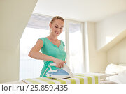 Купить «happy woman with iron and ironing board at home», фото № 25859435, снято 25 января 2015 г. (c) Syda Productions / Фотобанк Лори