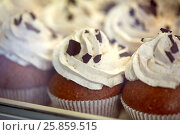Купить «close up of cupcakes or muffins with frosting», фото № 25859515, снято 3 октября 2016 г. (c) Syda Productions / Фотобанк Лори