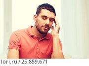 Купить «unhappy man suffering from headache at home», фото № 25859671, снято 15 января 2016 г. (c) Syda Productions / Фотобанк Лори