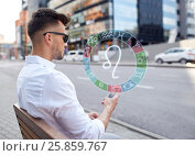 Купить «man with smartphone and zodiac signs in city», фото № 25859767, снято 21 августа 2016 г. (c) Syda Productions / Фотобанк Лори