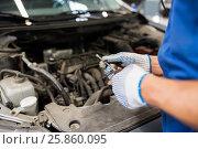 Купить «mechanic man with wrench repairing car at workshop», фото № 25860095, снято 1 июля 2016 г. (c) Syda Productions / Фотобанк Лори