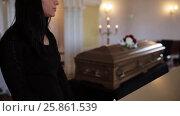 Купить «sad woman and coffin at funeral in church», видеоролик № 25861539, снято 22 марта 2017 г. (c) Syda Productions / Фотобанк Лори