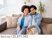 Купить «happy couple with selfie stick at home», фото № 25871343, снято 17 декабря 2016 г. (c) Syda Productions / Фотобанк Лори