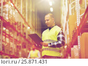 Купить «man with clipboard in safety vest at warehouse», фото № 25871431, снято 9 декабря 2015 г. (c) Syda Productions / Фотобанк Лори
