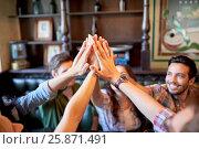 Купить «happy friends making high five at bar», фото № 25871491, снято 14 июля 2016 г. (c) Syda Productions / Фотобанк Лори