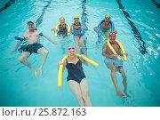 Купить «Swimmers swimming with pool noodles», фото № 25872163, снято 12 декабря 2016 г. (c) Wavebreak Media / Фотобанк Лори