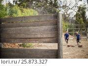 Купить «Fit man and woman running during obstacle course», фото № 25873327, снято 24 ноября 2016 г. (c) Wavebreak Media / Фотобанк Лори