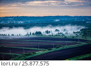 Купить «Aerial of agricultural russian village, dawn fog», фото № 25877575, снято 20 июля 2018 г. (c) Ирина Мойсеева / Фотобанк Лори