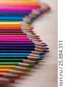 Купить «Bright colorful pencils on wooden table», фото № 25884311, снято 19 марта 2017 г. (c) Pavel Biryukov / Фотобанк Лори