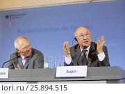 """Купить «Berlin, Germany. April 07, 2014. Joint press conference with Dr. BM Wolfgang Schäuble and new French Minister of Finance Michel Sapin on the subject """"...», фото № 25894515, снято 7 апреля 2014 г. (c) age Fotostock / Фотобанк Лори"""